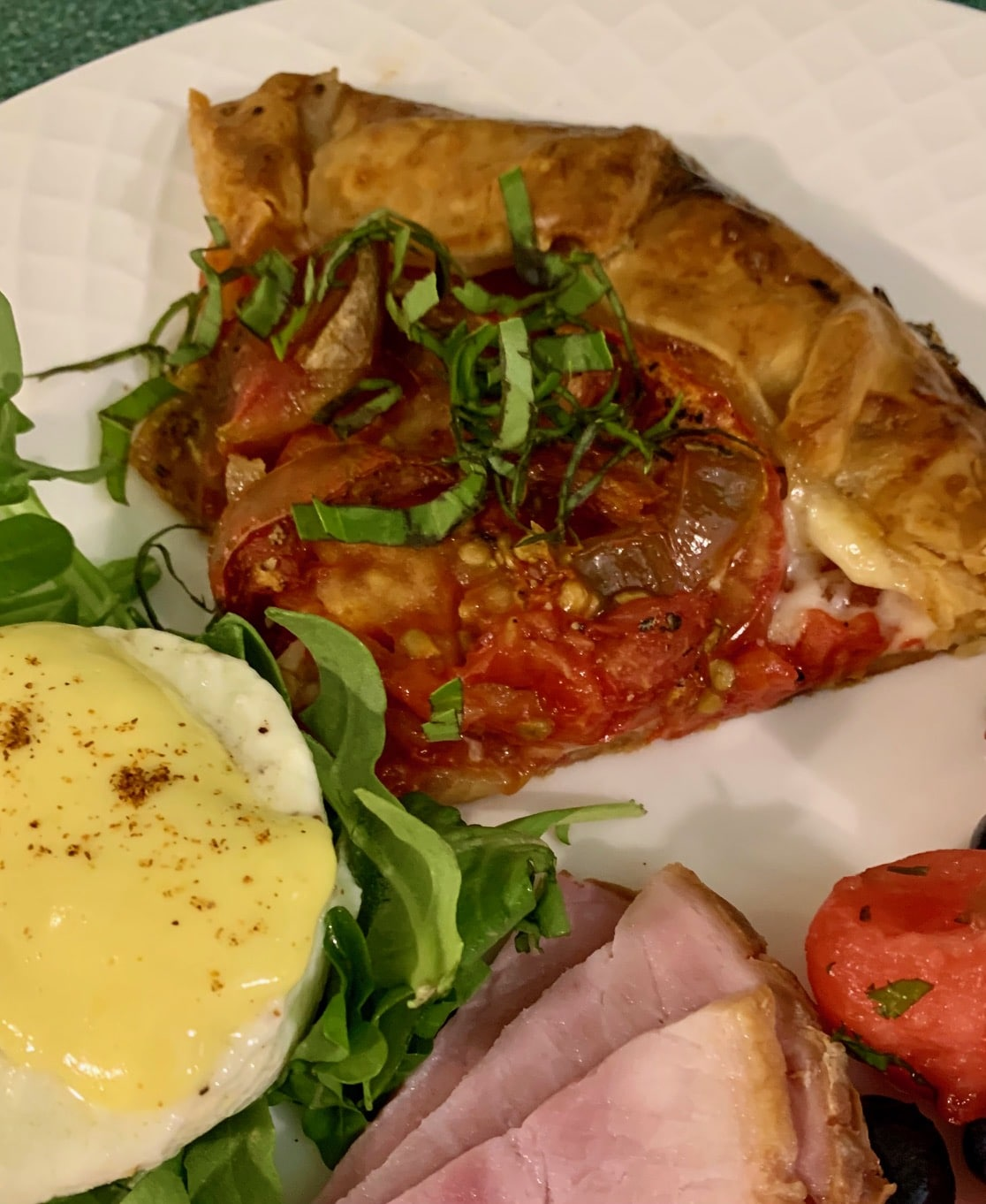 breakfast plate with tomato galette, and ham