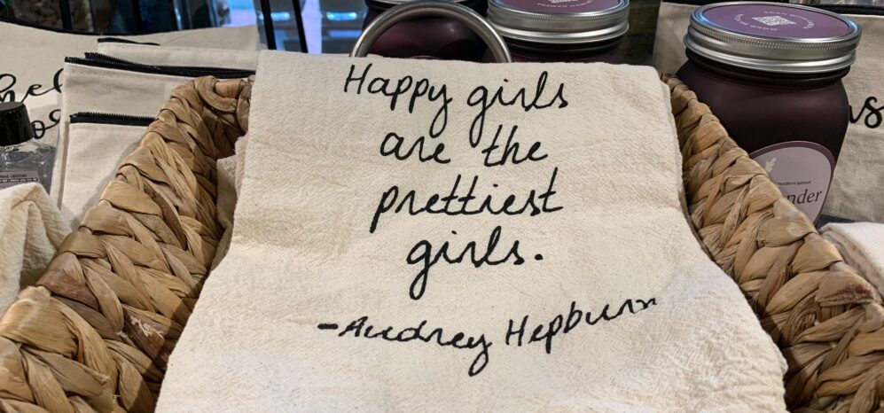 a white tea towel with script writing