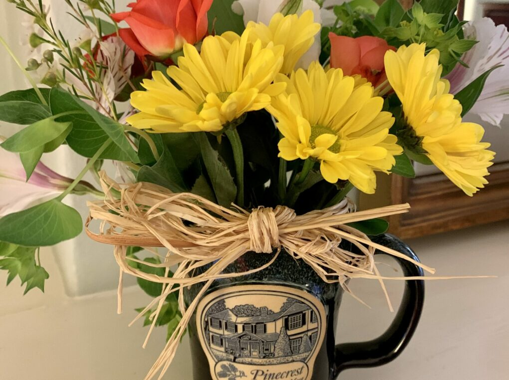 Pinecrest mug filled with daisies and flowers